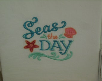 Beach themed Seas the Day flour sack towel. Machine embroidered.