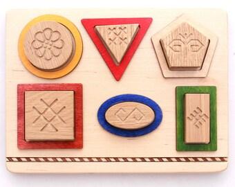 Wooden educational 6 geometric shapes with Latvian symbols