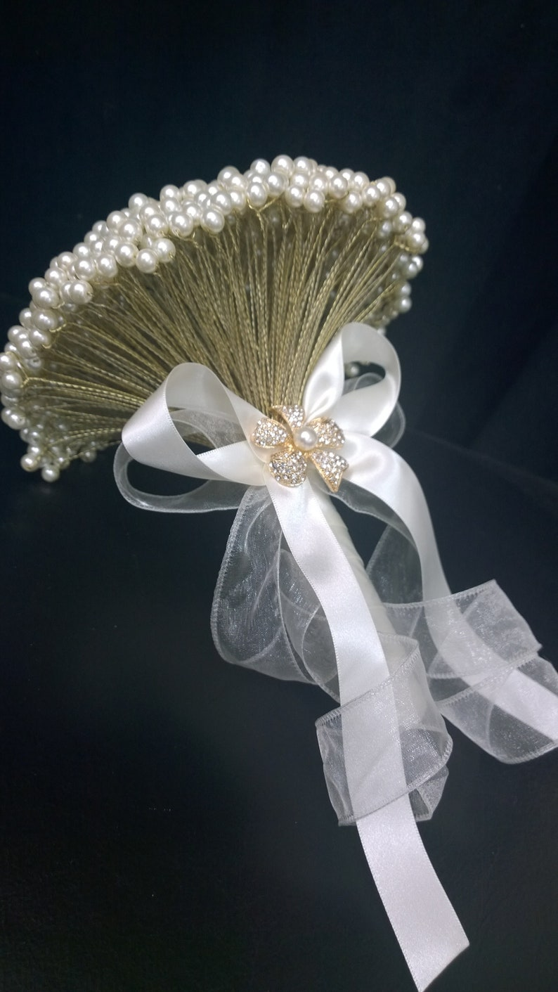 Perfect for a vintage wedding Pearl brides bouquet