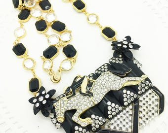 Take me to the Horse Races! One of a Kind Assemblage Necklace featuring Jockey on Race Horse.  Lot's of Glitz & Glamour! Fun and different.