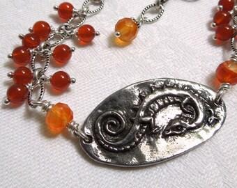 The Dragon Queen's Bracelet: Carnelian, Sterling Silver, Pewter