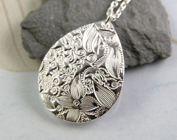 Silver Drop Necklace with a Fairytale Pattern