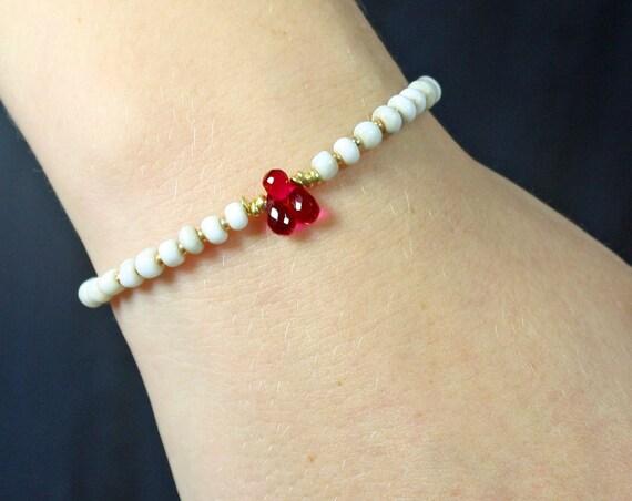Beaded bracelet. Pink Topaz and African bead bracelet. Ivory color glass Prayer Beads.  November Birthstone.