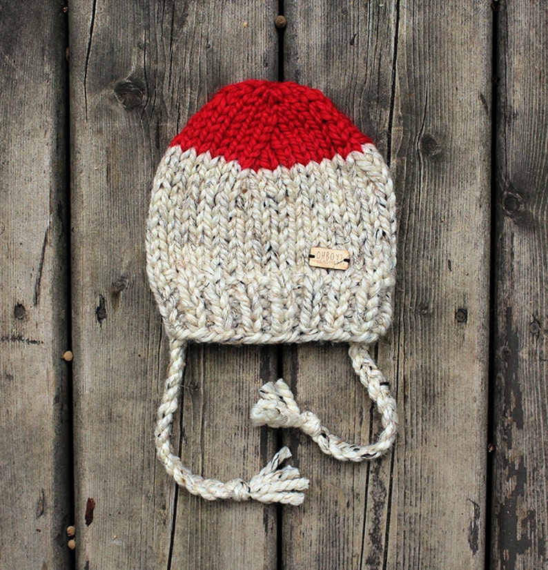 Bright red and heathered oatmeal chunky knit baby hat with ties