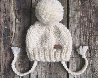 Cream chunky knit baby hat with pom-pom & ties