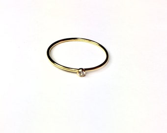 14k gold fill ring with tiny CZ diamond