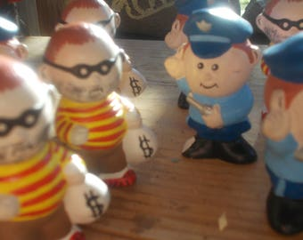 8  hand painted miniature ceramic people cops and robbers  for diorama ..shadowbox...