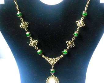 Bronze colour steampunk, victorian, goth necklace with green colour glass beads and cameo pendant.