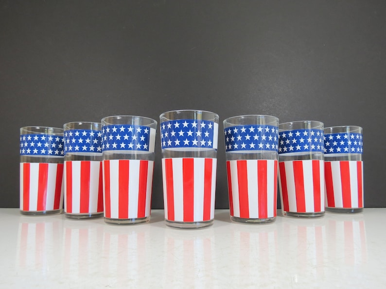 Vintage American Flag tumblers glass set. Come be inspired by 4th of July Tablescapes, Patriotic Decor & USA Finds: Happy Birthday, America in case you're in the mood for American flag and red, white, and blue festive finds.