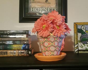 Gerbera Daisies in a Material Covered Clay Pot