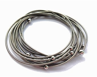 Piano Wire Bracelet Silver with silver beads