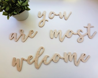 you are most welcome - wood cutout sign