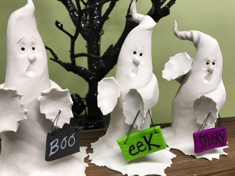 Ghost Holding Halloween Signs Spooky Eek Boo Halloween image 0