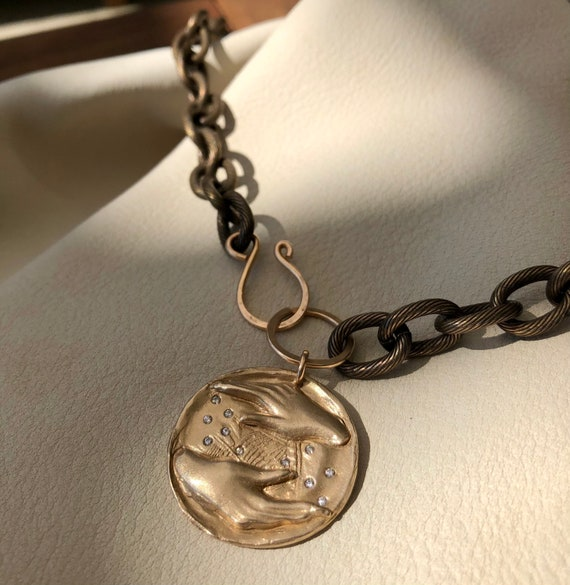 Manifest Medallion Front-clasping Necklace