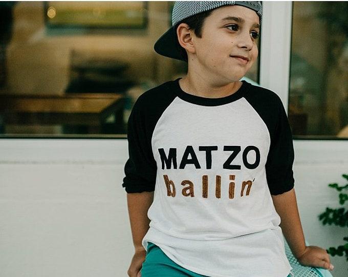 "Swanky Shank Gender Neutral Passover Tee ""Matzo Ballin'"""