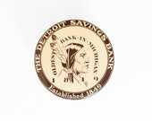 Circa 1920's The Detroit Savings Bank Novelty Advertising Celluloid Dime Bank With Native American Graphic.