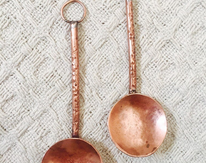 Couple of handmade copper serving spoons