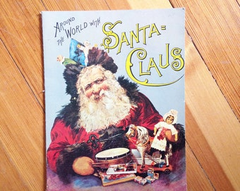 "Vintage Christmas Book / Replica of Antique Xmas Book / ""Around the Word with Santa Claus / Merrimack Publishing Co. / Printed in Hong Kong"