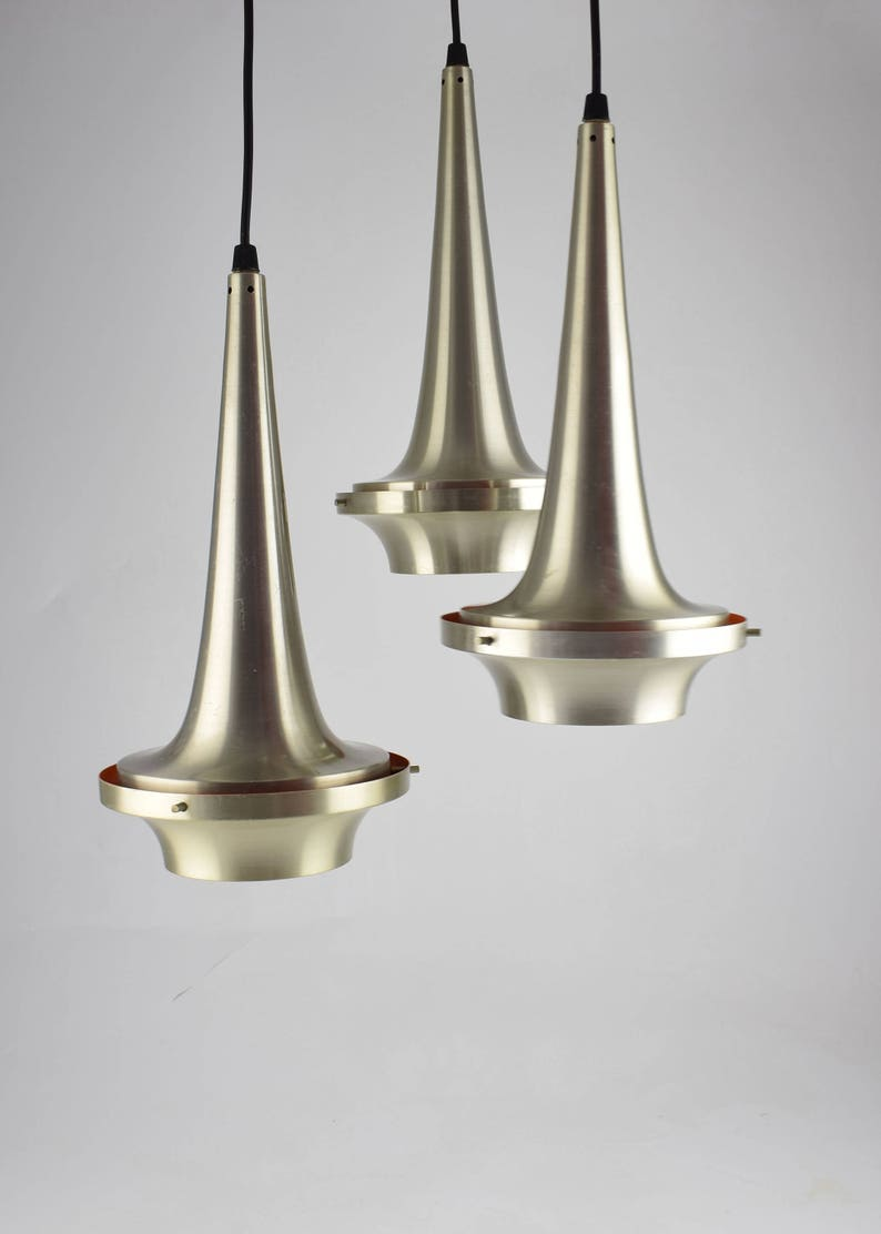 Cascade suspension lamp with three aluminum lights cascading image 0