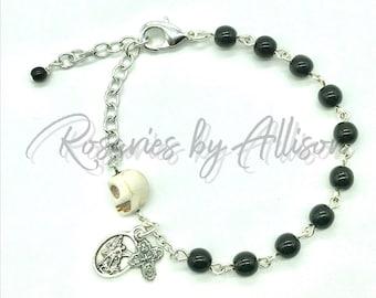 Memento Mori Rosary Bracelet with Black Czech glass beads, Silver St Michael, 4-way Cross, gold Miraculous Mary, skull bead