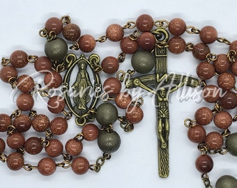Bronze plated Our Lady of Grace rosary with Brown Goldstone gemstone beads and Brass Round Our Father Beads
