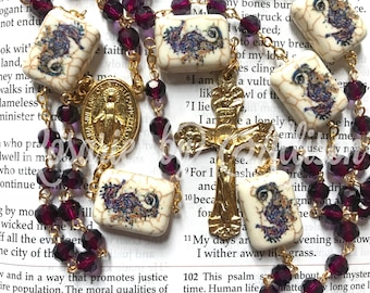 Purple faceted glass and Reconstituted Stone Seahorse bead rosary with gold plated Miraculous center and crucifix