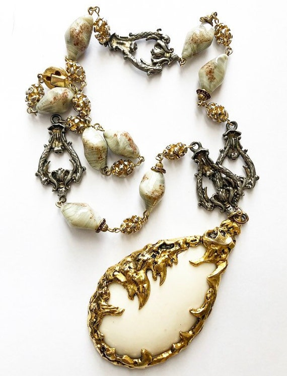 Gorgeous beaded necklace and brass brutalist penda
