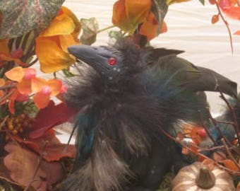 A Dracorvid In Autumn - hand-sculpted crow dragon with light-up seasonal floral arrangement display