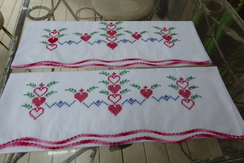 Vtg Hand Embroidered Pr White Cotton Pillowcases wCrochet Edge Red Hearts Green Leaves Blue Cross Stitch Standard Sz