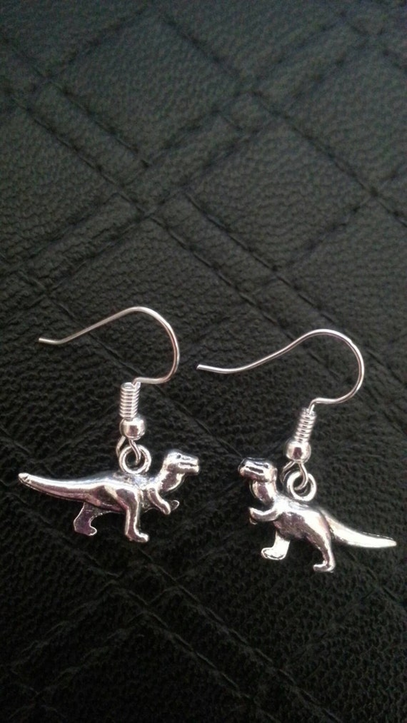 silver chain earrings mismatched trex charms long dangly punk trend dinosaur