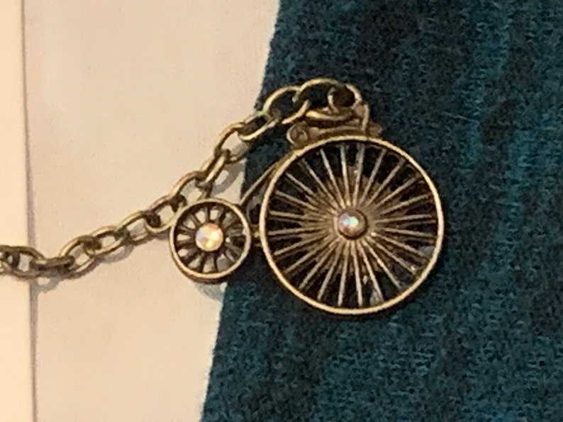 Antique Bike Sweater Clips Bicycle in Bronze