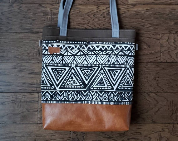Large tote/Black & white treddian print/Caramel brown vegan leather/Olive green bull denim/Gray canvas straps/4 pockets/Montana patch