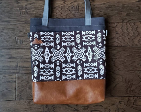Large tote/Brown & ivory SW print/Caramel brown vegan leather/Graphite gray bull denim/Gray canvas straps/4 pockets/MTN patch