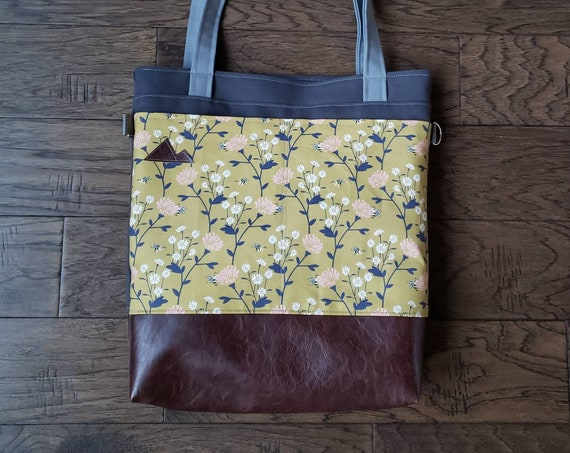 Large tote/Spring floral & bees on olive green/Dark brown vegan leather/Graphite gray bull denim/Gray canvas straps/4 pockets/MTN patch