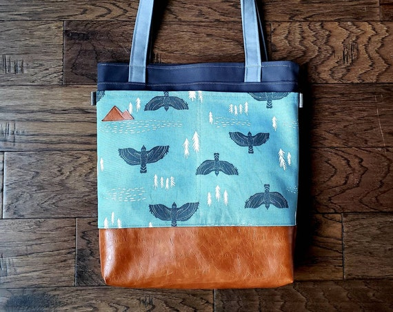 Large tote/Gray-blue with black hawks print/Caramel brown vegan leather/Graphite gray bull denim/Gray canvas straps/4 pockets/MTN patch
