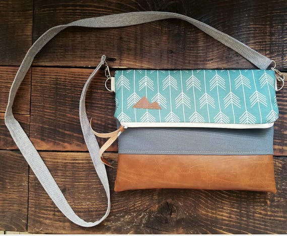 Crossbody/Dark teal arrows print/Mountain Patch/Foldover Crossbody/Caramel brown vegan leather/White zipper/Mountain patch bags