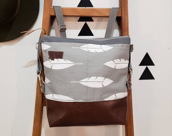 Convertible crossbody backpack/Light gray with white feathers print=2 front pockets/Vegan leather/Gray canvas shell/Gray zipper/MT or MTN