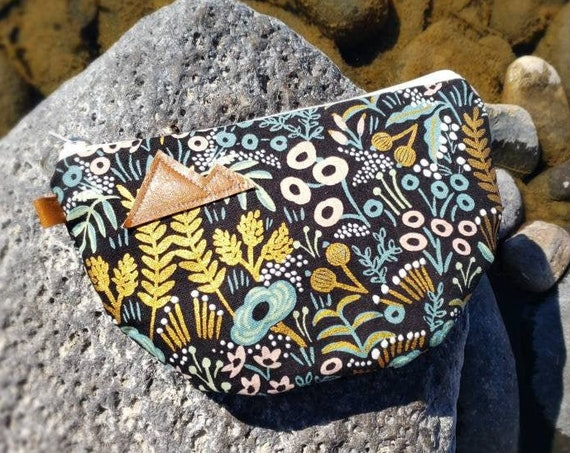 Half moon clutch/Golden floral print front and back/Natural canvas liner/White zipper/Montana or Mountain patch/Vegan leather
