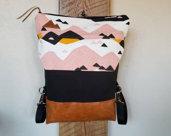 BACKPACK/Mountain top print in white,pink,orange black on black bull denim/2 front pockets/2 inside pockets/MT or MTN patch/Vegan leather