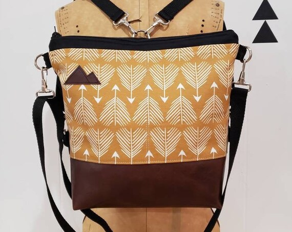 Convertible Backpack/Crossbody/Yellow feathered arrows print=2 front pockets/Black canvas/Black adjustable nylon straps/MT or Mountain