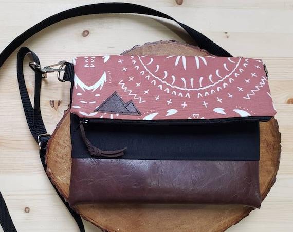 Foldover crossbody/Rust bohemian print/Black zipper/Black canvas reverse/Black nylon adjustable strap/Mountain or Montana patch