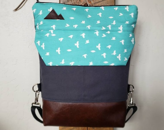 BACKPACK/White birds on teal print on graphite gray bull denim/2 front pockets/2 inside pockets/MT or MTN patch/Vegan leather details