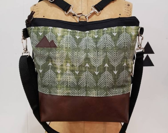 Convertible Backpack/Crossbody/Green feathered arrows print=2 front pockets/Black canvas/Black zip/Black adjustable nylon straps/MT or MT