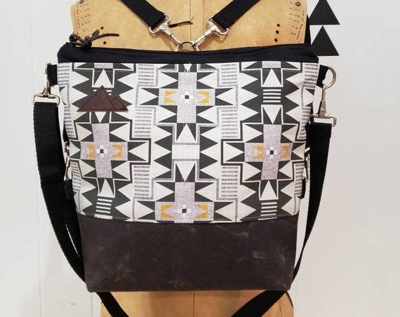 Convertible Backpack/Crossbody/Westward print=2 front pockets/Black canvas/Black zip/Black adjustable nylon straps/MT or Mountain