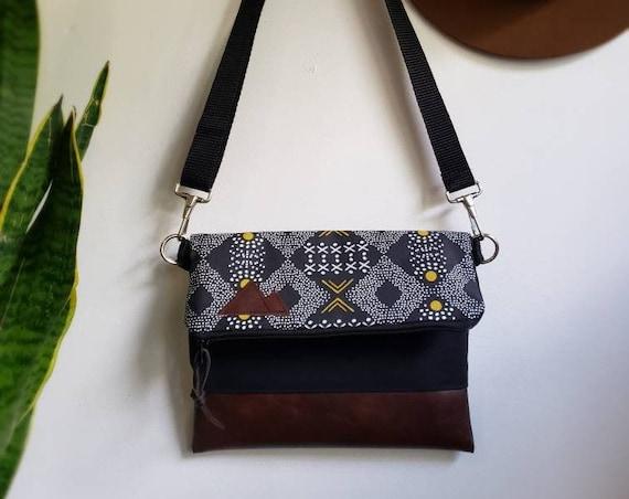 Foldover crossbody/Mud cloth print/Black zipper/Black canvas reverse/Black nylon adjustable strap/Mountain or Montana patch
