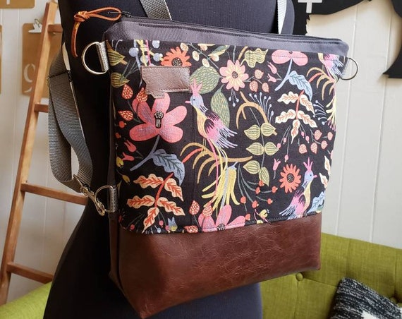 Convertible backpack crossbody/Funky floral print=2 front pockets/Vegan leather/Graphite gray bull denim shell/Black zipper