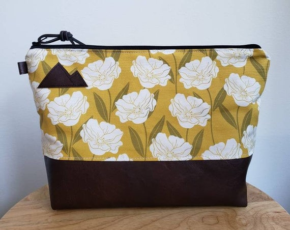 Travel bag/Golden floral print front and back/Flat bottom/Black zipper/ Heavyweight natural canvas liner/Montana or mountain patch
