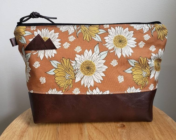 Travel bag/Orange sunflower print front and back/Flat bottom/Black zipper/ Heavyweight natural canvas liner/Montana or mountain patch