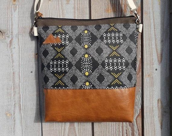 Large Crossbody/MTN patch/Black, white, olive Mud cloth print front pockets/Olive bull denim top&back/Caramel brown vegan leather/Black zip