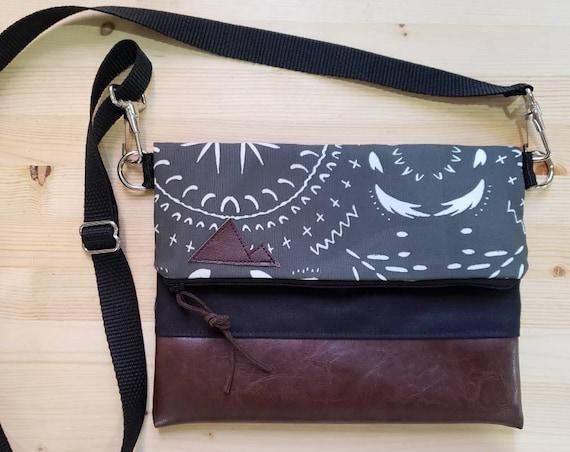 Foldover crossbody/Charcoal gray bohemian print/Black zipper/Black canvas reverse/Black nylon adjustable strap/Mountain or Montana patch